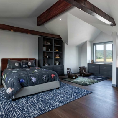 Contemporary bedroom in log home renovation
